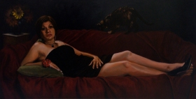 Young woman reclining and cat